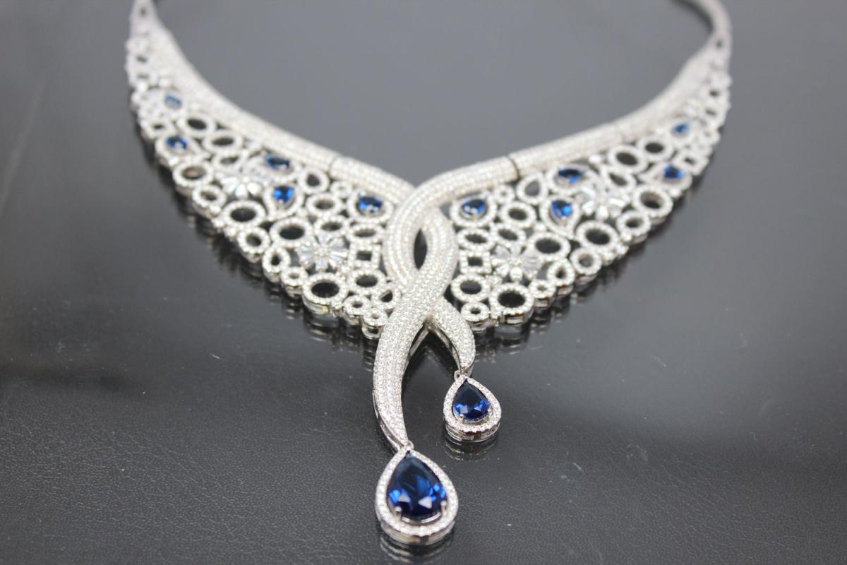aLEm necklace  Sea of Blossoms  with blue and white Zirconia 925/- Silver  rhodium plated with bolt clasp and security eight,
